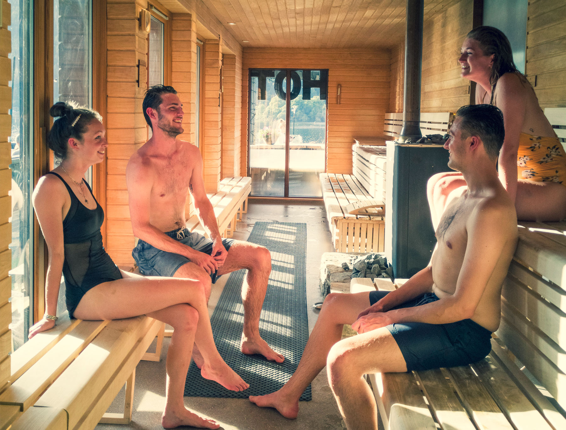 Four people sitting in the Hotbox Spa