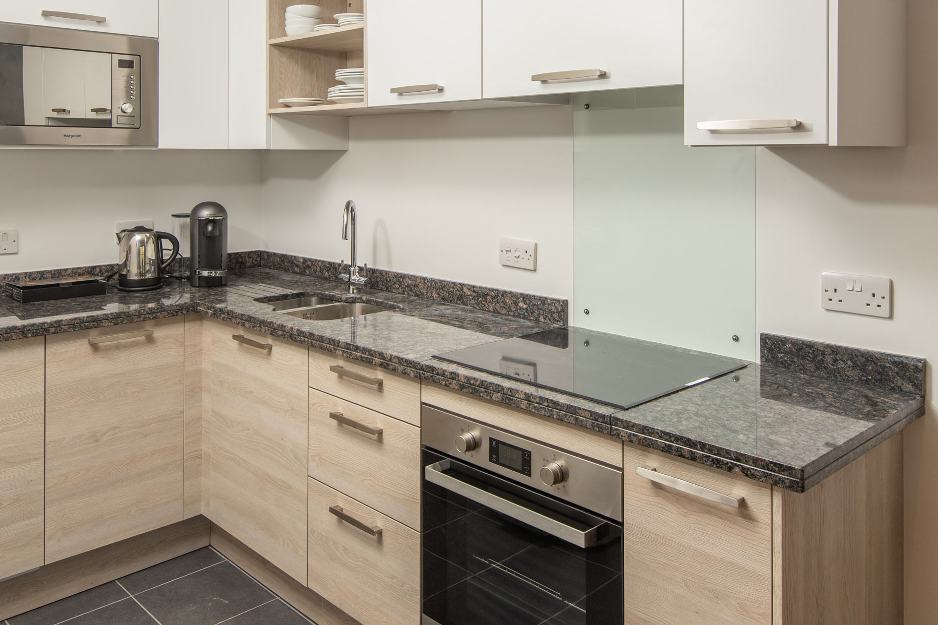 Contemporary White A Light Wood Kitchen With Dark Granite Worktops And Stainless Steel Appliances